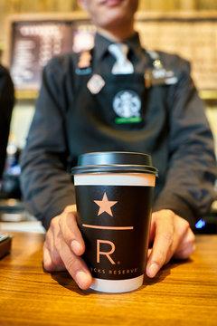 SHENZHEN, CHINA - CIRCA FEBRUARY,  2019: close up shot of paper cup at Starbucks in Shenzhen.