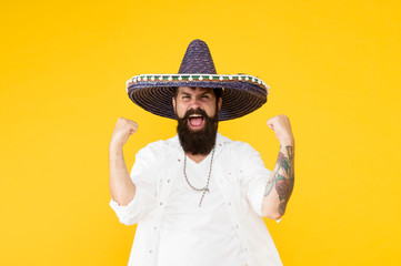 Festival concept. Hipster having fun. Mexican performer. Mexican traditions. Explore mexican culture. Celebrate traditional holiday. Happy man sombrero souvenir straw hat. Plan summer vacation