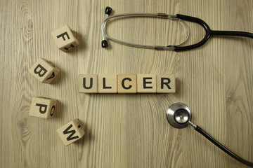 Word ulcer from wooden blocks with stethoscope