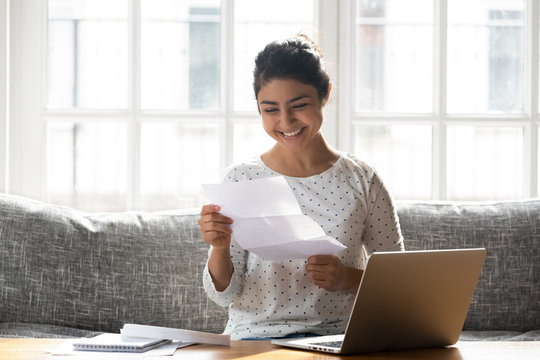 Happy woman holding paper reading good news college admission concept