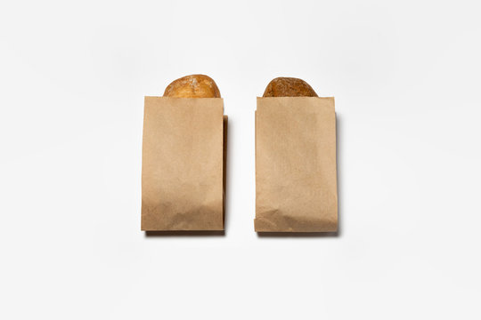 Fresh Black and White Bread in a brown kraft Paper Bag Mockup on white background.High resolution photo.