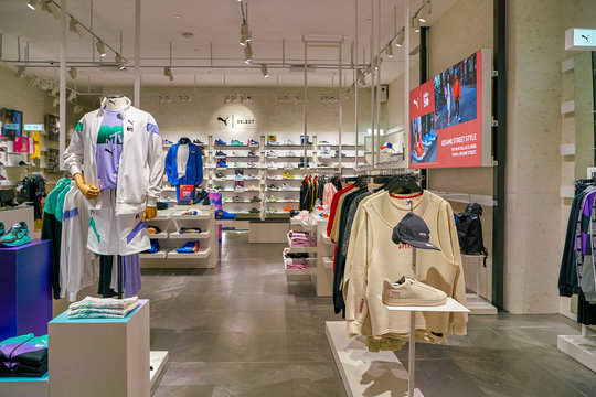 SINGAPORE - CIRCA APRIL, 2019: clothes and footwear on display at Puma Select store in the Shoppes at Marina Bay Sands.
