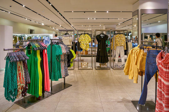 SINGAPORE - CIRCA APRIL, 2019: clothes on display at Zara store in the Shoppes at Marina Bay Sands.