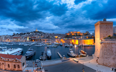 Fototapete - Night Old Port with Forts Saint-Jean and Saint-Nicolas, the Basilica of Notre Dame de la Garde on the background, on the hill, Marseille, France