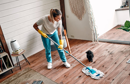 Woman doing house cleaning.