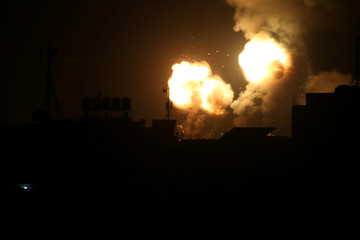Flame and smoke are seen during Israeli air strikes in the southern Gaza Strip