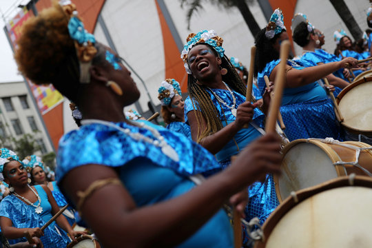 Women play drums during the afro female block Ilu Oba de Min in Sao Paulo