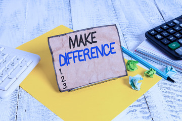 Word writing text Make Difference. Business photo showcasing to cause a change To be important or significant in some way Notepaper stand on buffer wire in between computer keyboard and math sheets