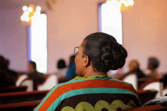 A portrait of an African-American woman sitting in church