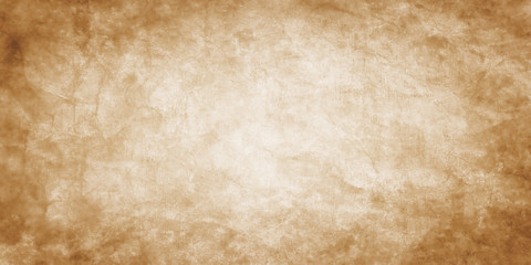 Wall Mural - Old brown paper parchment background design with distressed vintage stains and ink spatter and white faded shabby center, elegant antique beige color