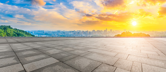 Foto auf Acrylglas Melone Wide square floor and city skyline at sunrise in Hangzhou,China.