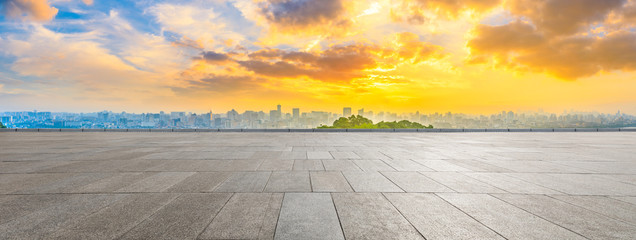 Wide square floor and city skyline at sunrise in Hangzhou,China. Fotomurales