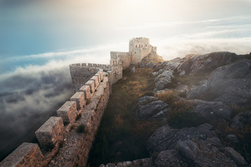 Medieval fortress, wall and tower landscape with cloudy sky. Wall mural