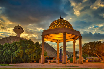 Gazebo Dome bathed in Golden light along with the Frankincense burner monument in the evening. From Muscat, Oman.