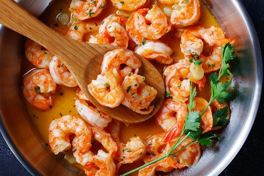Italian shrimp scampi on a skillet, close-up