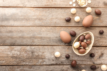 Sweet chocolate Easter eggs on wooden background