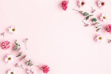Fotobehang Bloemenwinkel Flowers composition. Pink flowers and eucalyptus branches on pink background. Valentines day, mothers day, womens day concept. Flat lay, top view