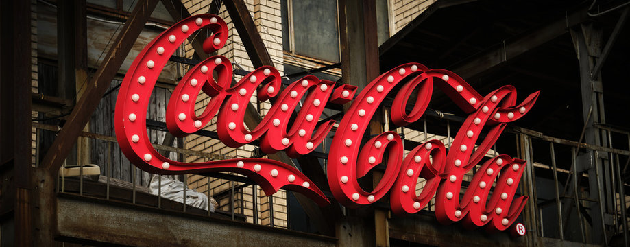 "MINSK, BELARUS - FEBRUAR 18, 2020: an electronic signage ""Coca Cola"" on metal constructions."