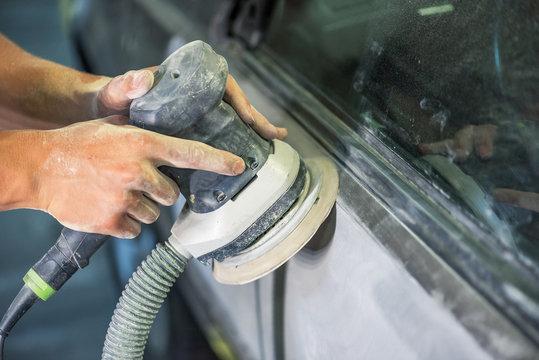Bulgarian mechanic working in auto shop.