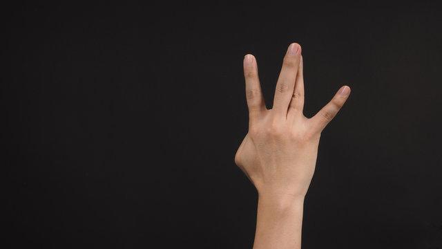 Hip-hop west coast hand sign on black background.