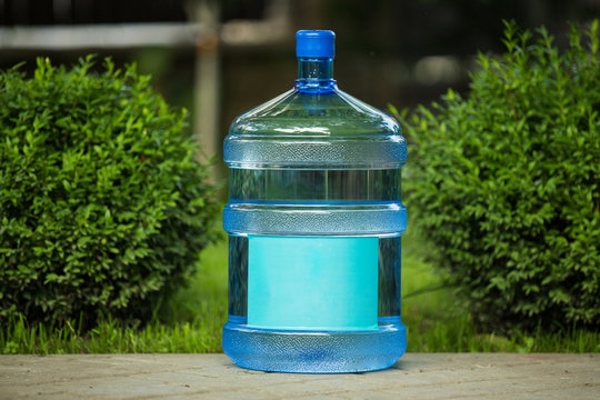 Large water bottle on grass in garden