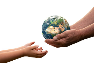 Close up of senior hands giving small planet earth to a child isolated on white background Fotomurales