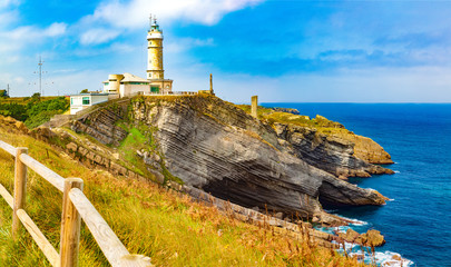 Foto op Plexiglas Noord Europa Countryside and cliff in Santander.Tour tourism in Cantabria,Spain.Beautiful natural landscape Cabo Mayor Lighthouse.Scenery coastline and evening sky.