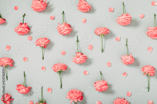 Beautiful flowers composition. Pink rose flowers on gray background. Valentines Day, Easter, Birthday, Happy Women's Day, Mother's day. Flat lay, top view, copy space
