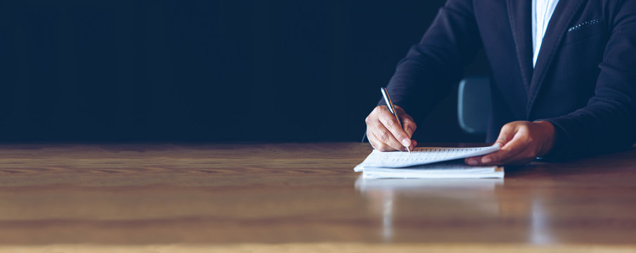businessman check the work documents in office,The media reaches the operational guidelines, signing a contract, for panoramic banner background with copy space