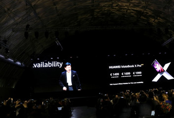 Richard Yu, CEO of Huawei Technologies Consumer Business Group talks to the audience on a big screen during Huawei stream product launch event in Barcelona