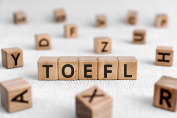 TOEFL - words from wooden blocks with letters, The Test of English as a Foreign Language, TOEFL...