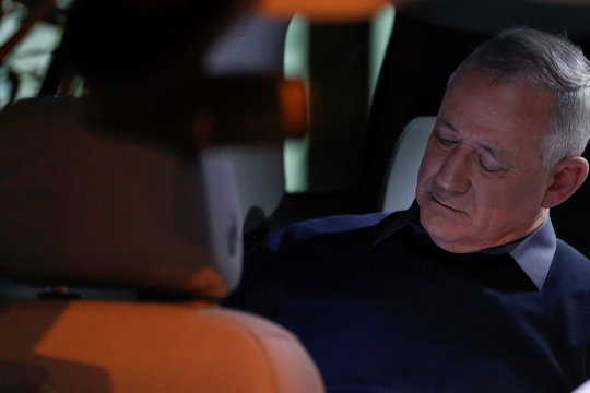 Benny Gantz, leader of Blue and White party, sits in his car before he delivers a statement on the cross-border violence with Gaza, in Sha'ar HaNegev