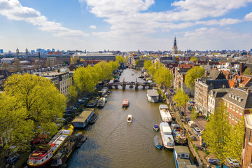 Fotomurales - Amsterdam skyline in historical area, Amsterdam, Netherlands. Ariel view of Amsterdam. Landscape and nature travel, or historical building and sightseeing concept.