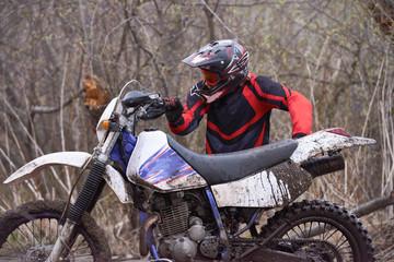 Biker tugging morobike out of mud