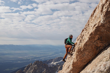 Male rock climber ascends the Exum Ridge route on the Grand Teton.
