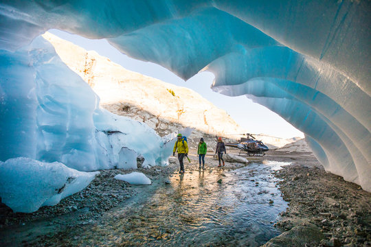 Three adventurers enter a glacial cave.