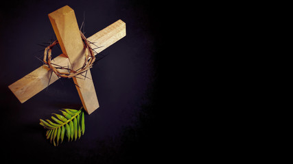 Lent Season,Holy Week and Good Friday concepts - closed up wooden cross,crown of thorns and palm leave in dark background