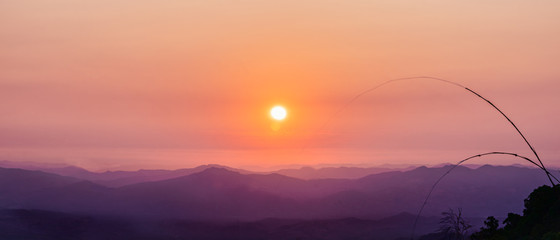 natural landscape background of sunrising over mountains with orange sky