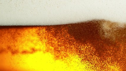 Wall Mural - Super slow motion of macro shot of beer drink, close-up. Filmed on high speed cinema camera, 1000 fps.