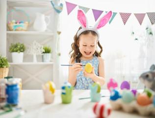 child painting eggs
