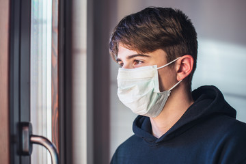young boy with protective mask - pandemic infection fear concept - quarantine at home - stay at home