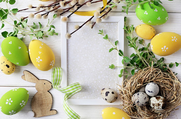 greeting card with colorful easter eggs and spring flowers. mock up frame with copy space
