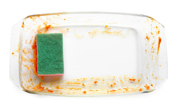 Dirty empty baking dish with sponge on white background