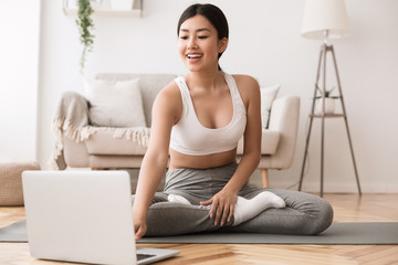 Printed roller blinds Yoga school Sport application. Asian girl practicing yoga and using laptop