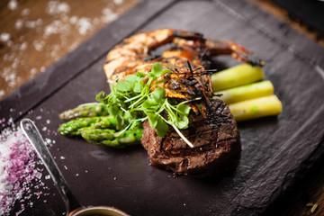 Tasting menu. Beef steak and grilled tiger prawns.