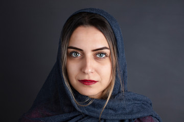 portrait of blue eyed middle eastern woman
