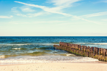 Fototapete - calming view of horizontal line of sea breakwaters and beach