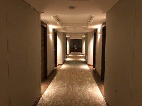Empty Corridor with Doors in Luxurious Hotel