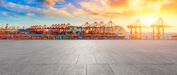 Empty floor and industrial container freight port at beautiful sunset in Shanghai.