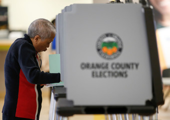A voters cast their ballots in the March 3 Super Tuesday primary as new voting procedures and technology are used to make voting easier and more secure in Santa Ana, California